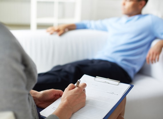 Man receiving counselling